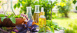Leinwandbild Motiv Oil for skin care, massage from natural ingredients, herbs, mint in glass jars and test tubes on a green background in the garden on the nature, natural cosmetics