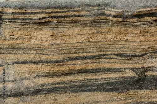 Fotografering background of cross section dirty sand layers in nature beach