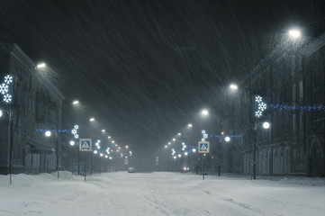 Winter landscape with snowstorm in city