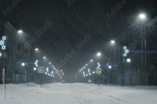 Photo  Winter landscape with snowstorm in city