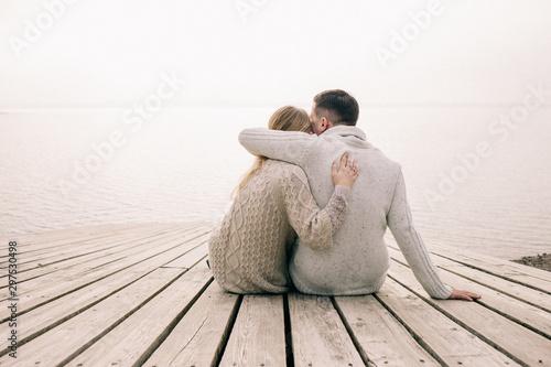 couple hugging on a pier Fototapeta