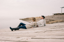 Couple Hugging On A Pier