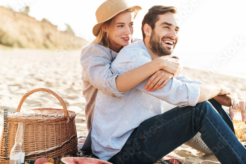 Cheerful young couple in love having picnic
