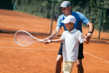 Boy On Tennis Training