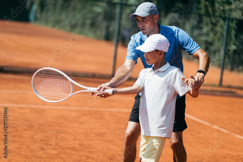 Fotomural Boy on Tennis Training