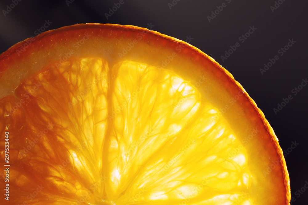 Fototapety, obrazy: orange slice macro with a drop of water background . juicy orange sliced closeup on a dark background
