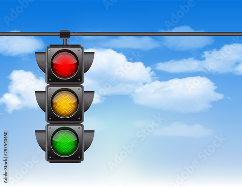 Traffic lights with all three colors on hanging against blue sky Fototapete