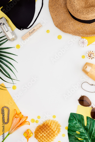 Obraz wooden block with june inscription, digital camera, lily flower, green leaves, sunglasses, sunscreen, lollipops waffles, bikini bra isolated on white - fototapety do salonu