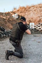 Man Practice Shooting Gun, Rifle Outdoors.