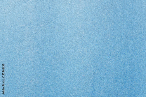 Blue color cardboard. Clean light blue paper texture. High resolution photo.