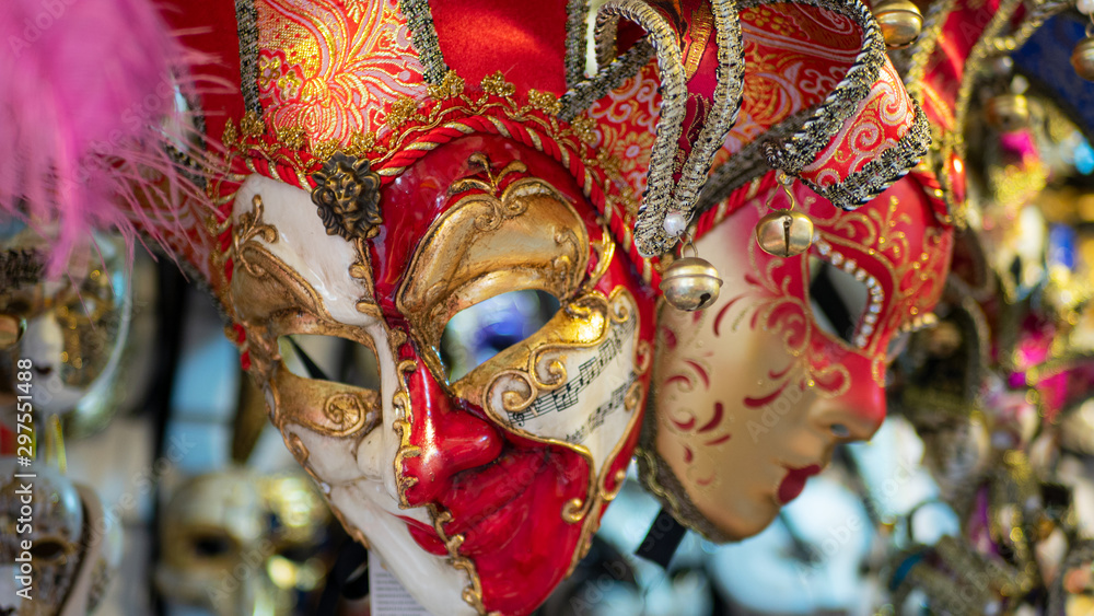 Beautiful venetian masks in store on street, traditional carnival of Italy.