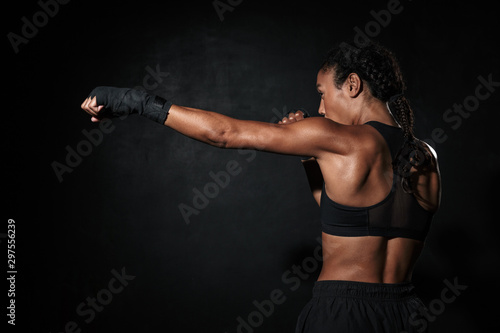 Image of muscular african american woman boxing in hand wraps Canvas-taulu