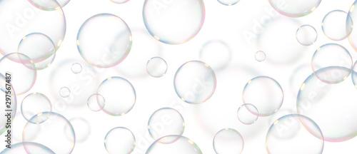 Obraz na plátne  fondo de pompas de jabón flotando haciendo un patrón en fondo blanco aislado