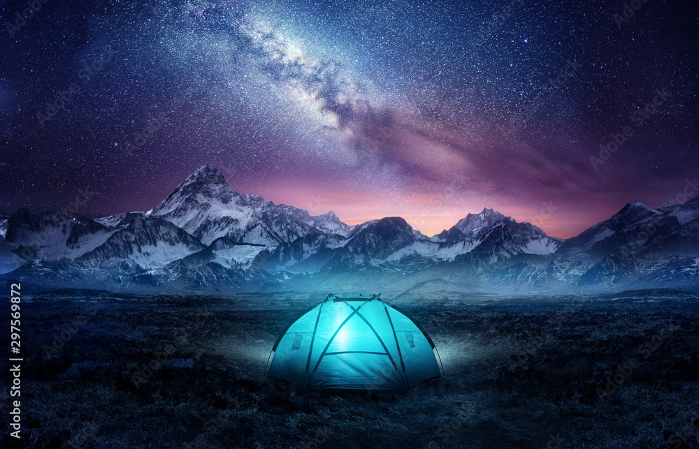 Fototapety, obrazy: Camping in the mountains under the stars. A tent pitched up and glowing under the milky way. Photo composite.