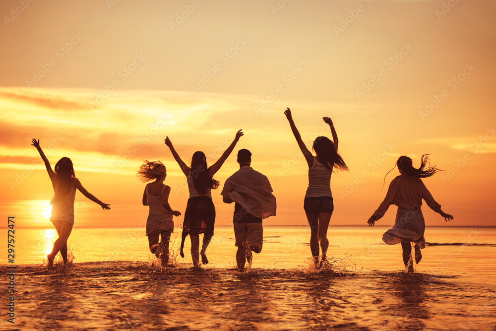 Fototapety, obrazy: Big group of happy friends at sunset beach party