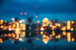 Leinwandbild Motiv Oslo, Norway. Night Abstract Boke Bokeh Background Effect. Design Backdrop. Night View Embankment And Residential Multi-storey House In Gamle Oslo District. Residential Area Reflected In Sea Waters
