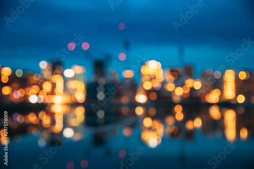 Oslo, Norway. Night Abstract Boke Bokeh Background Effect. Design Backdrop. Night View Embankment And Residential Multi-storey House In Gamle Oslo District. Residential Area Reflected In Sea Waters - 297576009