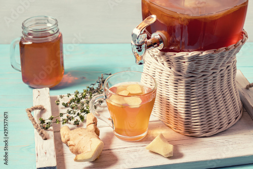 Fresh homemade kombucha fermented tea drink in a jar with faucet and in a cup an Wallpaper Mural