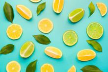 Ripe Cut Lemons And Limes On C...