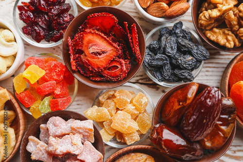 Fotografía  Different dried fruits on white table, top view