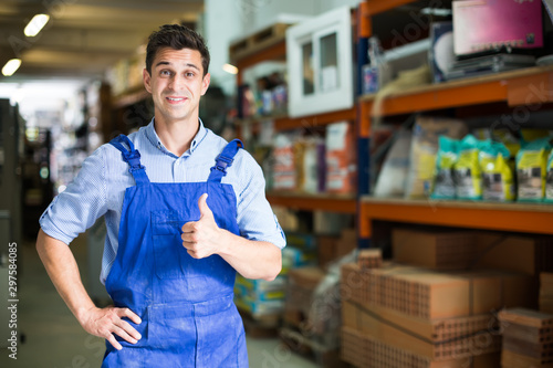 Fotomural  Portrait of male in uniform on his work position in building store