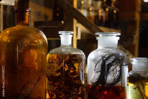 Photo Set of alchemy bottles in laboratory of alchemist