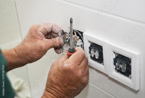 Electrican repair and installing socket, outlet plug Fototapet