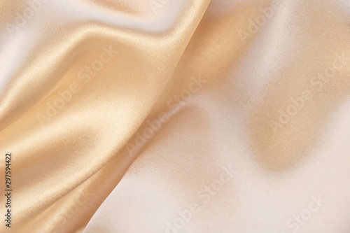 Photo Shiny beige luxury silk background