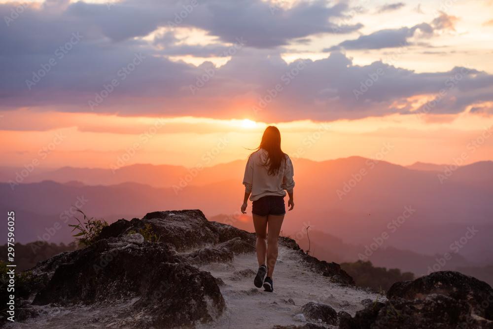 Fototapety, obrazy: Slim beautiful girl walks mountains at sunset