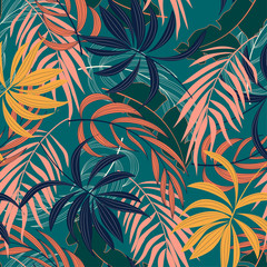 FototapetaFashionable seamless tropical pattern with bright blue and yellow plants and leaves on green background. Beautiful print with hand drawn exotic plants. Seamless pattern with colorful leaves and plants