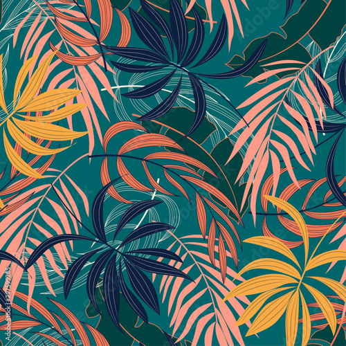 Poster Artificiel Fashionable seamless tropical pattern with bright blue and yellow plants and leaves on green background. Beautiful print with hand drawn exotic plants. Seamless pattern with colorful leaves and plants