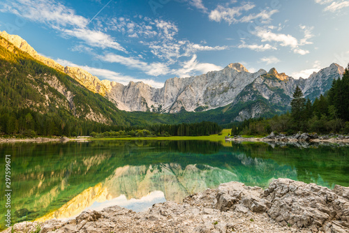 Foto auf AluDibond Blau Beautiful Day at Fusine Lake in Italy. Forest and Mountains Reflection in Emerald Lake Water