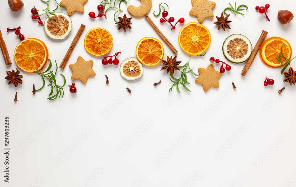 Fototapety, obrazy:  Christmas composition with cookies, dried oranges, cinnamon sticks and herbs on white background. Natural food ingredient for cooking or Christmas decor for home. Flat lay.