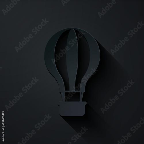 Fotografija  Paper cut Hot air balloon icon isolated on black background