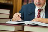 Businessman reading a book