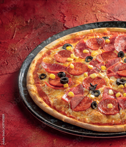 mixed pizza red background