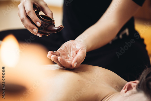 Poster Spa Aromatherapy massage is massage therapy using massage oil or lotion that contains essential oils
