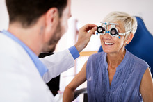 Senior Woman Taking An Eyesight Test Examination At An Optician Clinic