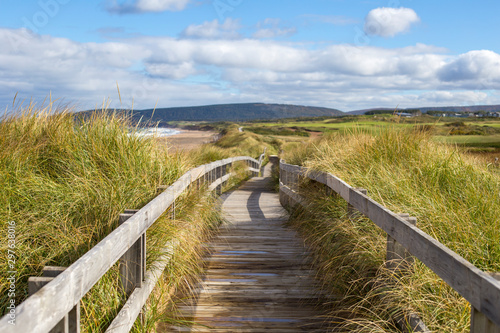 Valokuva Wood boardwalk at Inverness Beach on Cape Breton Island, Nova Scotia, Canada on autumn day