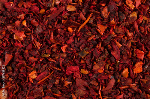 Crushed pepper, red background of spices. Copy space. Wallpaper Mural