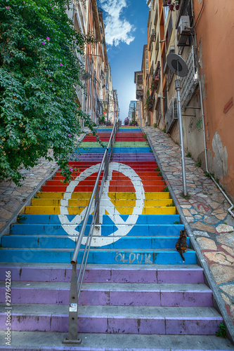 Montage in der Fensternische Graffiti A peace sign on colorful and tall steps in Izmir, Turkey