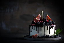 Cake Decorated Blackberries And Figs With Candle