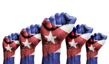 A Raised Fist Of A Protesters Painted With The Cuba Flag
