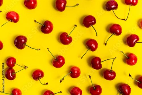 Obraz na plátne Fresh cherry fruit on yellow background