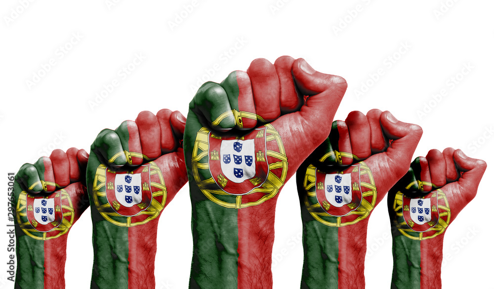 Fototapety, obrazy: A raised fist of a protesters painted with the Portugal flag