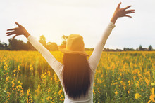Beauty Happy Woman Raised Hands Up Carefree To Sky At Bloom Blossom Agriculture Field,