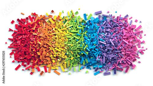Pile of colorful rainbow toy bricks isolated on white background - 297655828