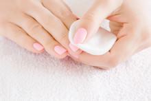 Woman Hand Removing Pink Nail ...