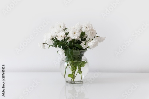 white roses isolated in glass bowl - 297667628