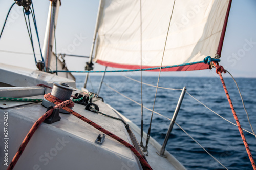 Fototapety, obrazy: Close up of a red rope and a sail knot on a sailboat in Riviera of Athens in Greece